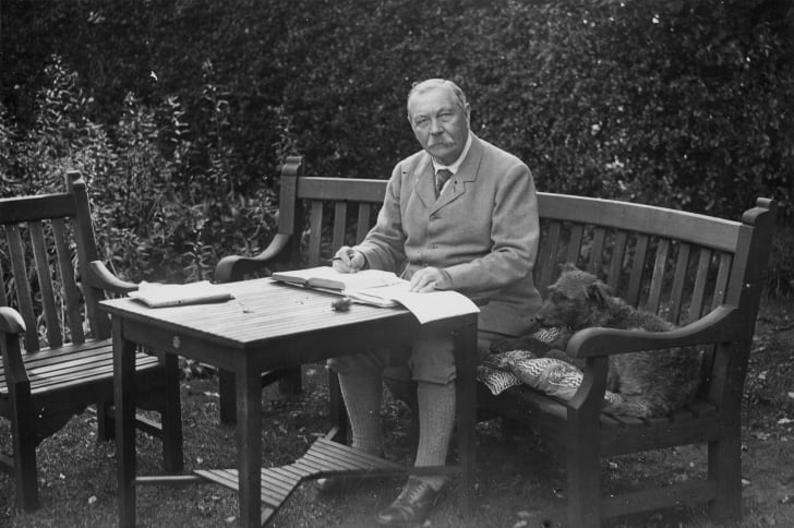 A picture of Arthur Conan Doyle with his dog.