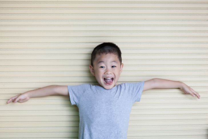 Photo of young boy wearing a T-shirt
