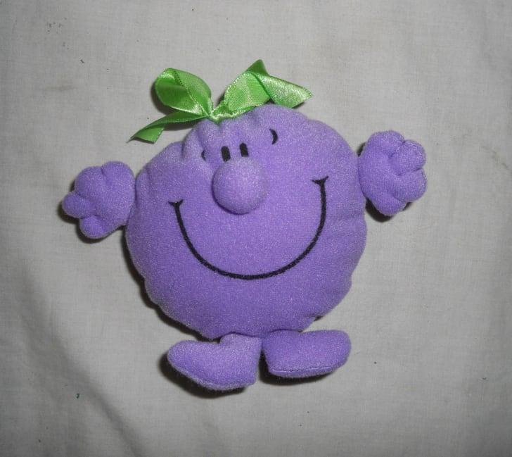 A purple Mr. Men Happy Meal toy.
