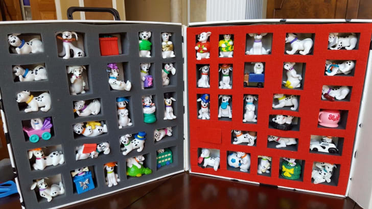 A box of 101 Dalmations Happy Meal Toys.