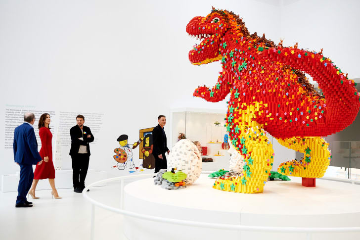 LEGO House visitors browse the Masterpiece Gallery, a display of works by members of the brand's artistic community.