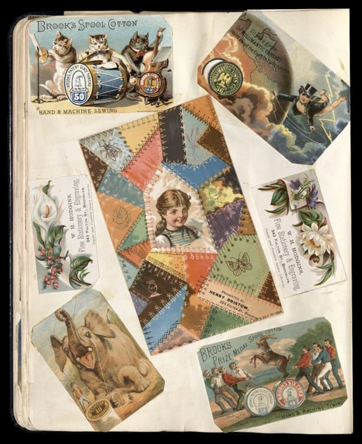 Full view of scrapbook page including 3 trade cards for Brooklyn businesses: W. H. Hodgins, Henry Bristow