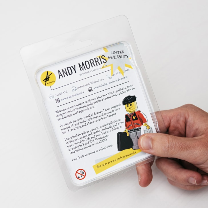The back side of a mock-LEGO minifig package.