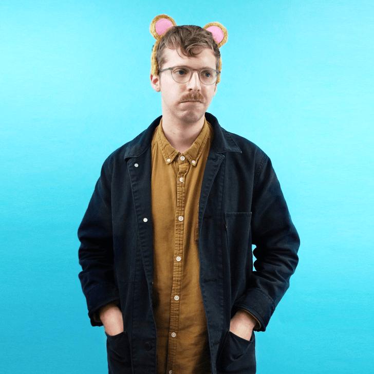 A man wearing bear ears.