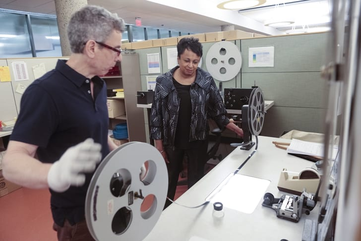 Carla Hayden looking at a film reel with an expert at the Culpepper Library of Congress campus,