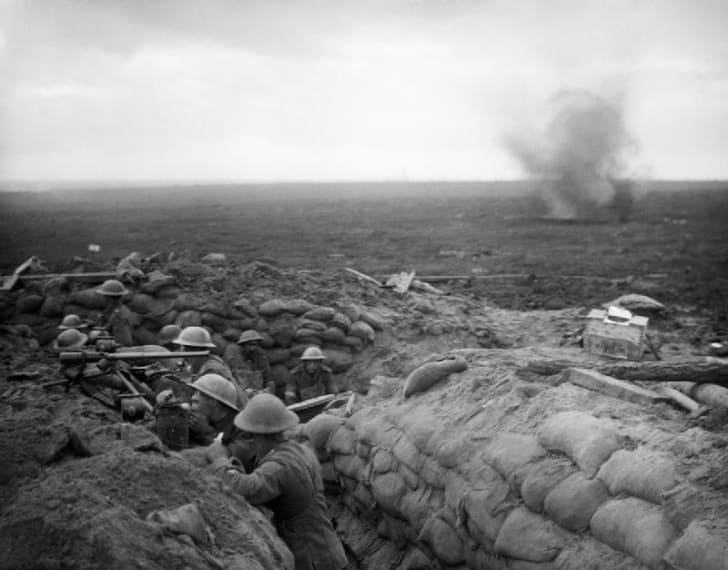 A signals section of the 13th Battalion, Durham Light Infantry, equipped with telescopes, field telephone and signalling lamps, await news of the progress of the unit's attack towards Veldhoek during the Battle of Menin Road