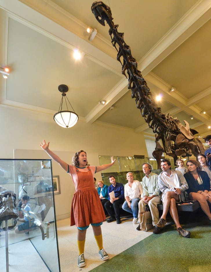 Soprano Jennifer Zetland (Rhoda) sings in front of a dinosaur skeleton at the American Museum of Natural History.