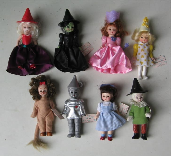 A set of 7 small Madame Alexander dolls dressed like Wizard of Oz characters.