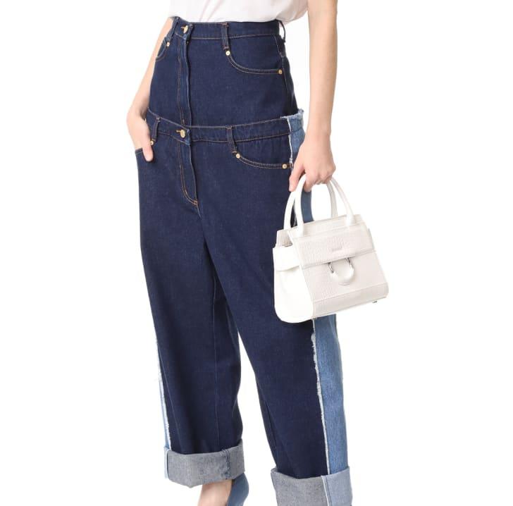 Model wearing double jeans.