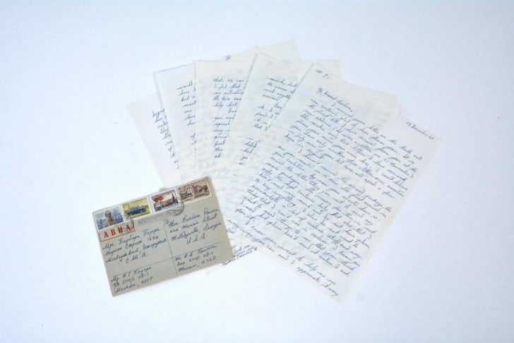 Pages of a letter and a postcard.