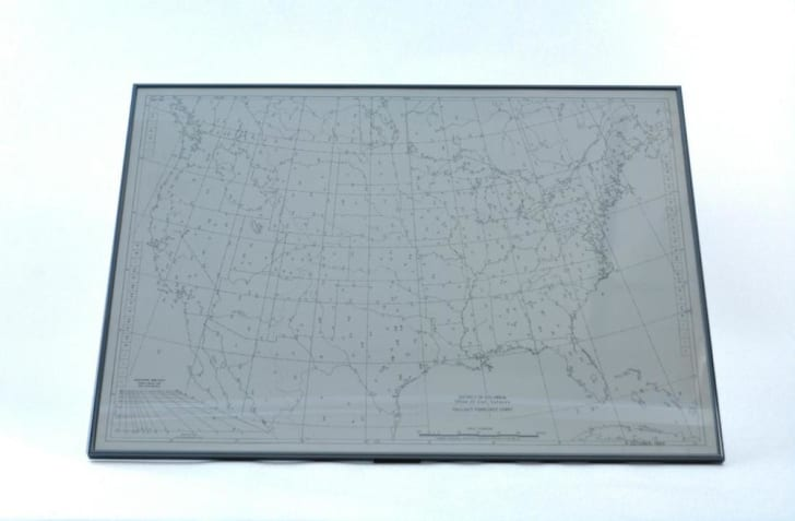 Map of the U.S. framed behind glass.
