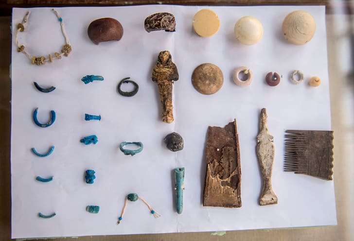 Jewelry, statues, and other artifacts discovered in the tomb.