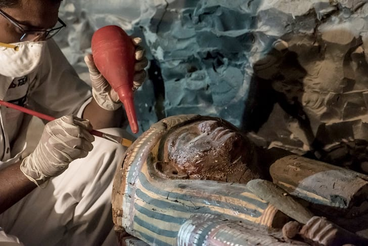 egyptian archaeologist restoring the sarcophagus of a goldsmith