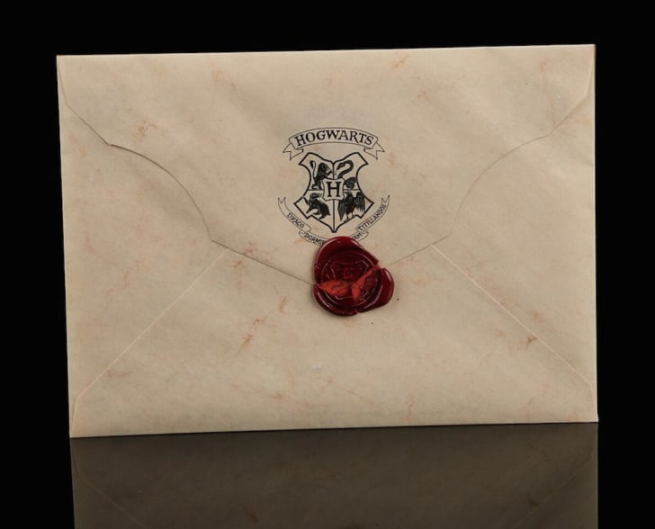 """Back of Hogwarts acceptance letter prop from """"Harry Potter and the Sorcerer's Stone"""" (2001)."""