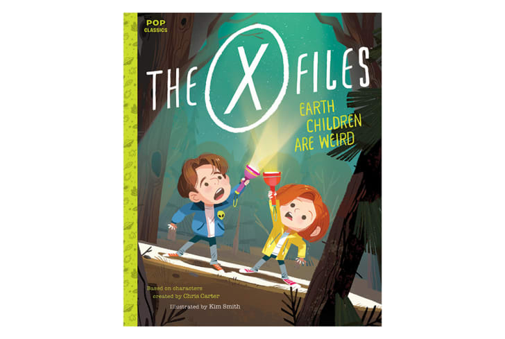 The cover of 'Earth Children Are Weird' shows Mulder and Scully shining their flashlights up toward the sky.