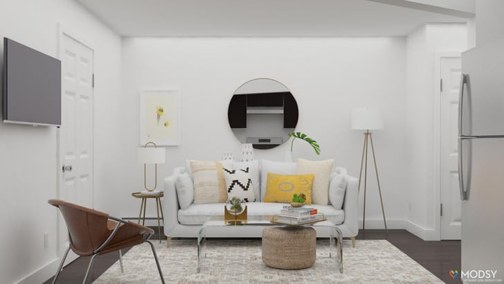 A rendering shows an apartment featuring a white couch and several lamps against a wall.