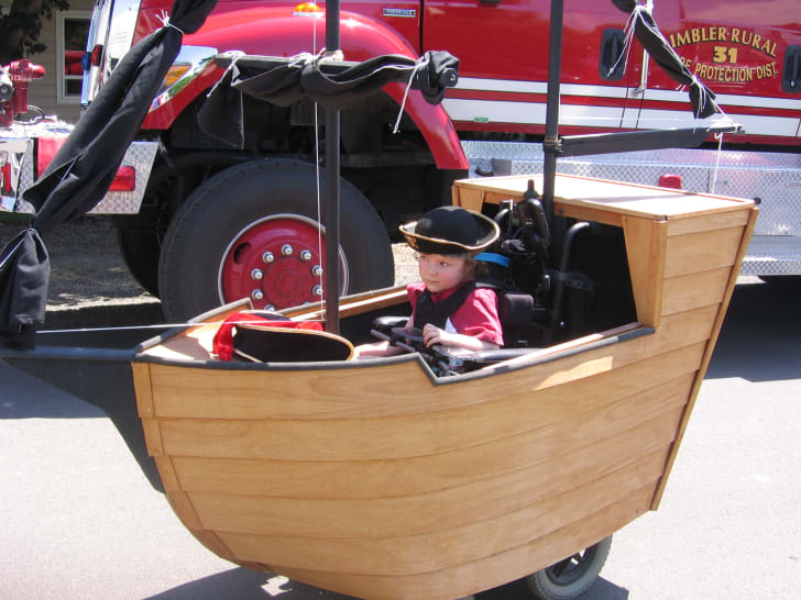 A custom pirate ship Halloween costume, created by Magic Wheelchair founder Ryan Weimer for his son, Keaton.
