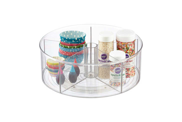 A product shot shows a round, plastic organizer with baking products inside.