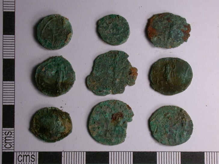 Coins from a Roman treasure stash discovered by metal detector hobbyists in Cornwall, England