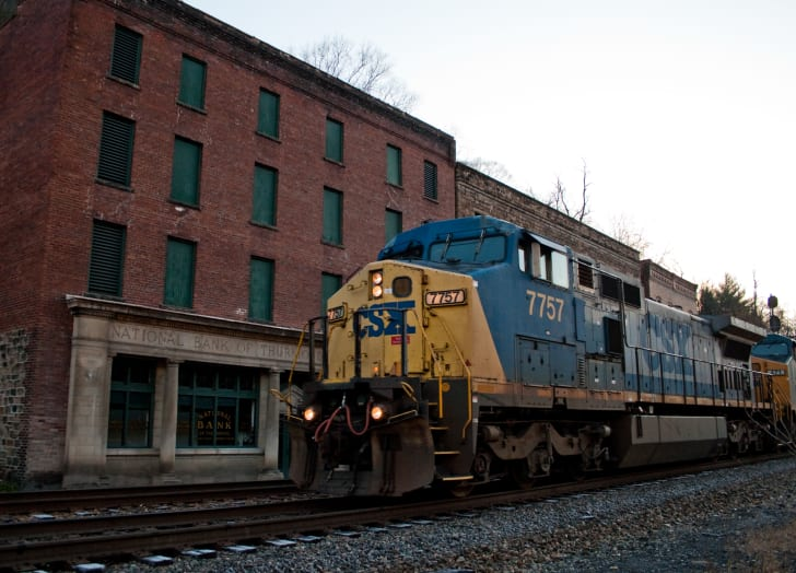 A CSX train rolls by the defunct National Bank of Thurmond