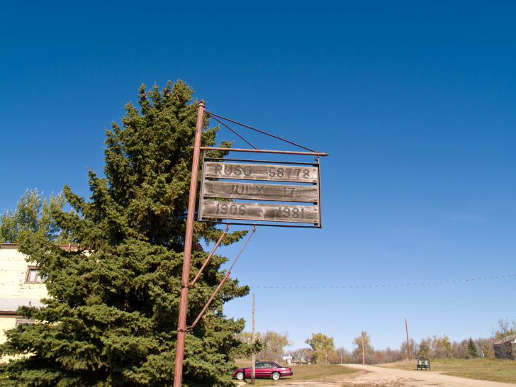Wooden sign for Ruso, North Dakota