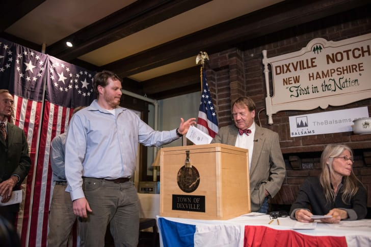 A man casts his ballot in Dixville Notch's midnight primary election in 2016
