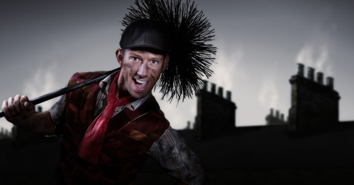 A photograph of a very happy chimney sweep
