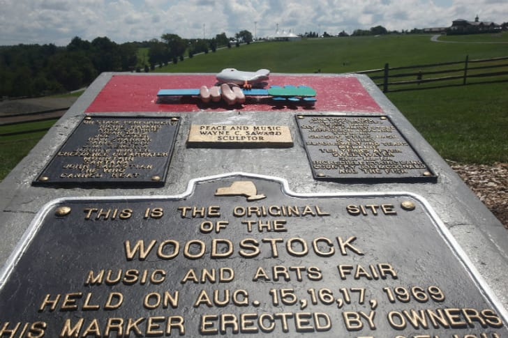 A plaque stands at the original site of Woodstock in Bethel, New York