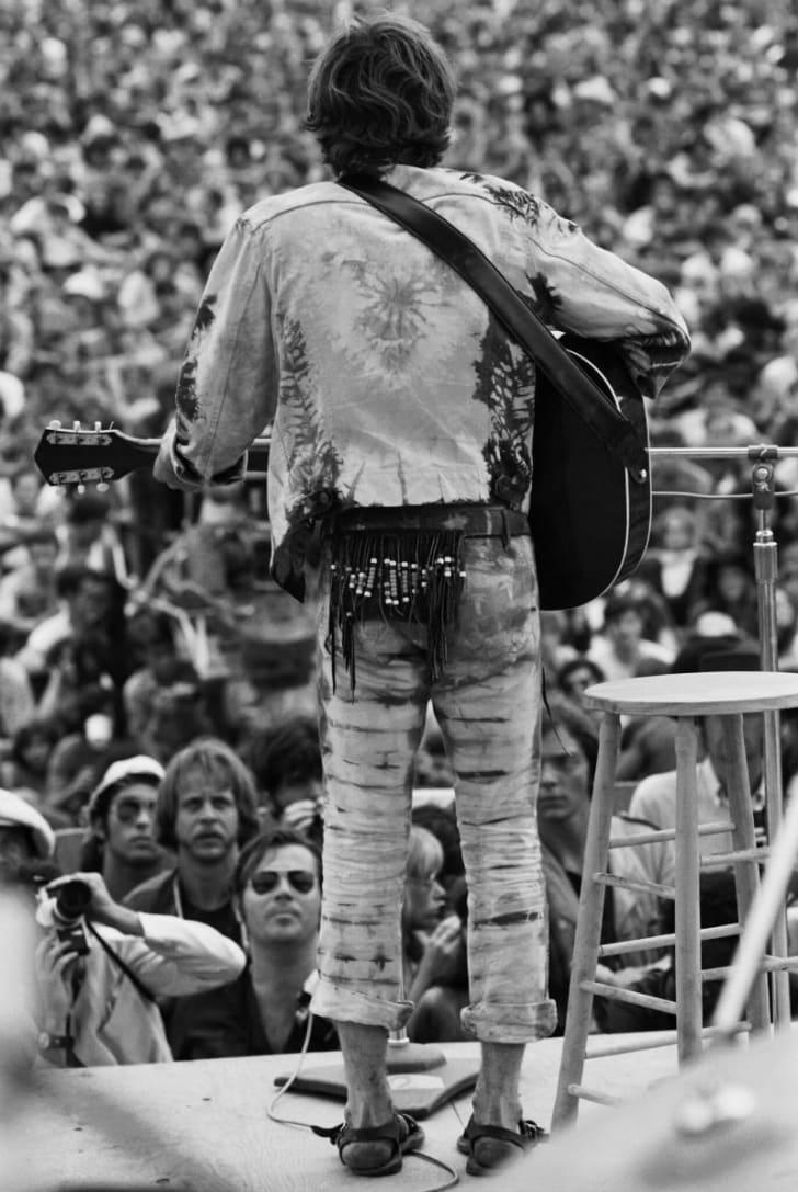 Musician John Sebastian performs at Woodstock in 1969