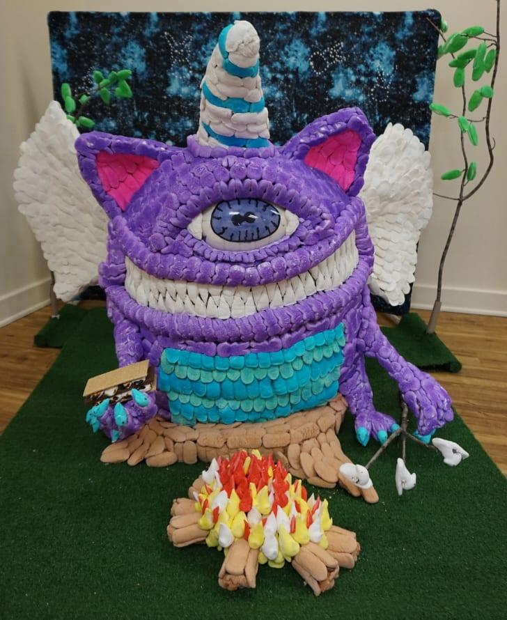 A sculpture of a monster