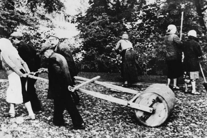 Jewish civilians repair road damage in March 1941.