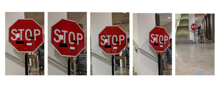 Five different views of a stop sign with black and white block-shaped stickers seen from various angles and distances.