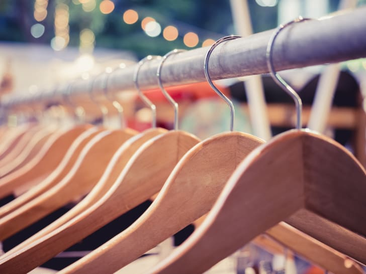 Wooden hangers on a clothing rack
