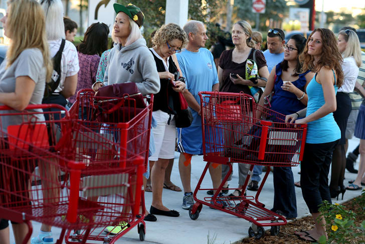 People waiting in line outside a Trader Joe's in Miami
