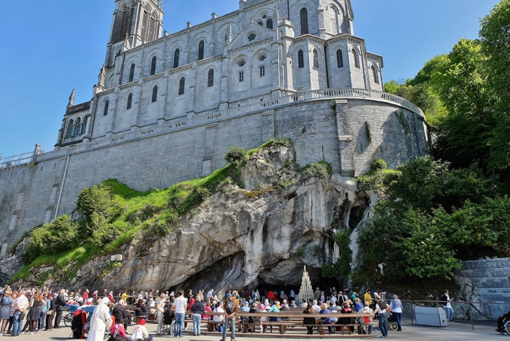 Pilgrims visiting the Sanctuary of Our Lady of Lourdes in Lourdes, France.