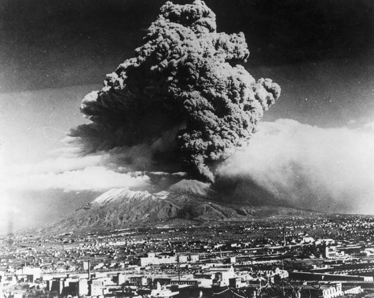 A cloud of ash hangs over Vesuvius.