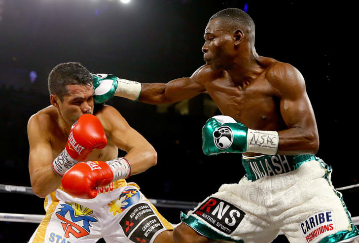 Guillermo Rigondeaux throws a right to the face of Drian Francisco during their junior featherweight bout.