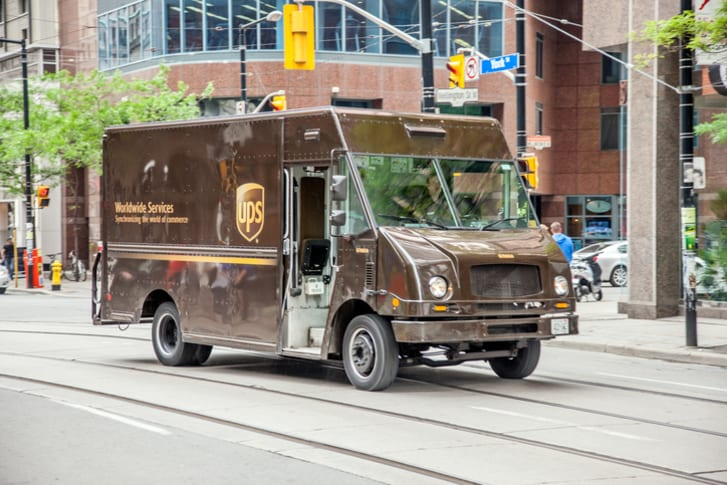 ups truck drives down the street