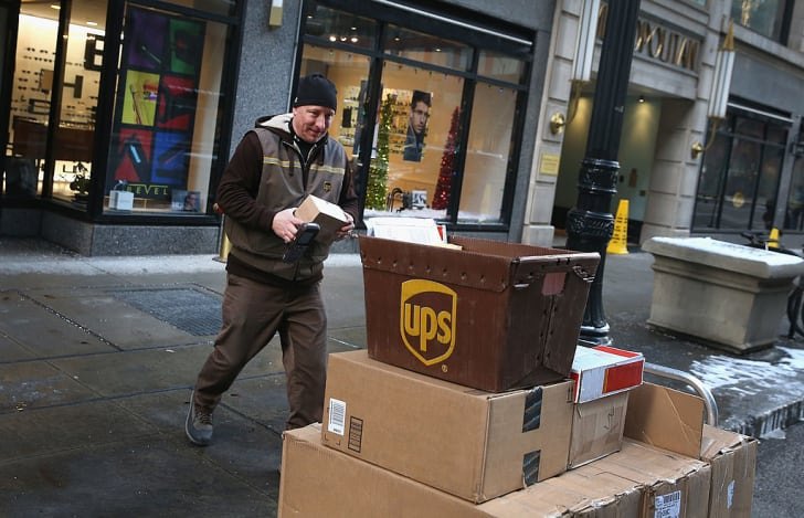 A UPS worker delivers packages
