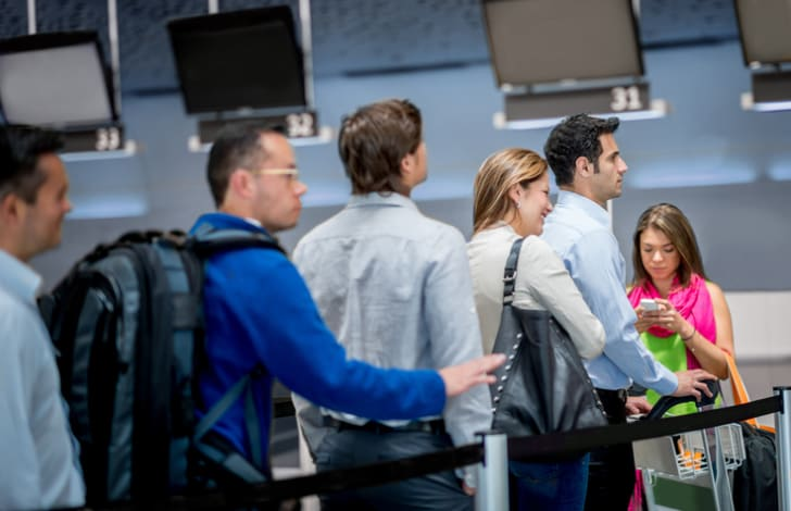 people standing in a single-file line at airport security