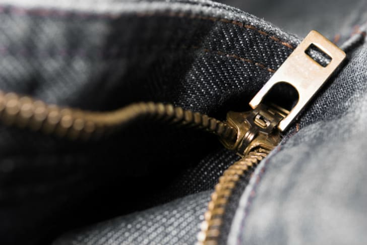 A jeans zipper appears on the right side