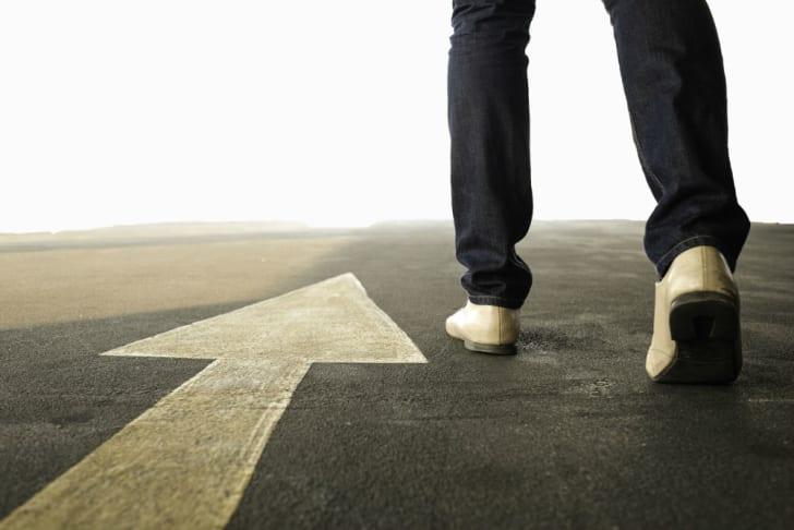 A man walks along a stretch of road