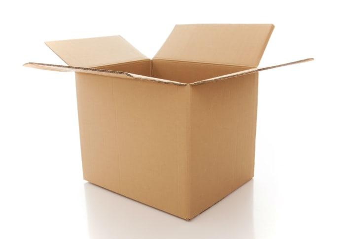 An open cardboard box sits empty