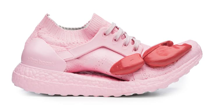 Pink running shoe with lobster claw.