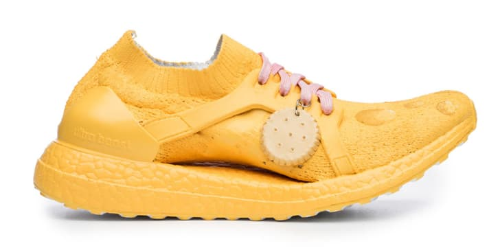 Yellow running shoe with cracker tag.