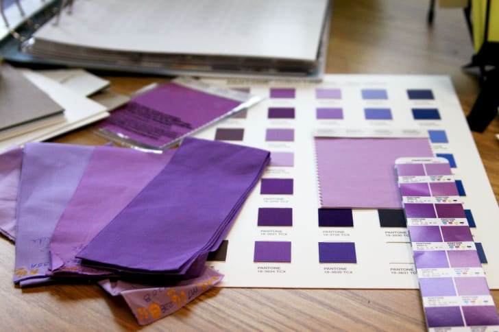 Samples of Pantone colors arrayed on a table