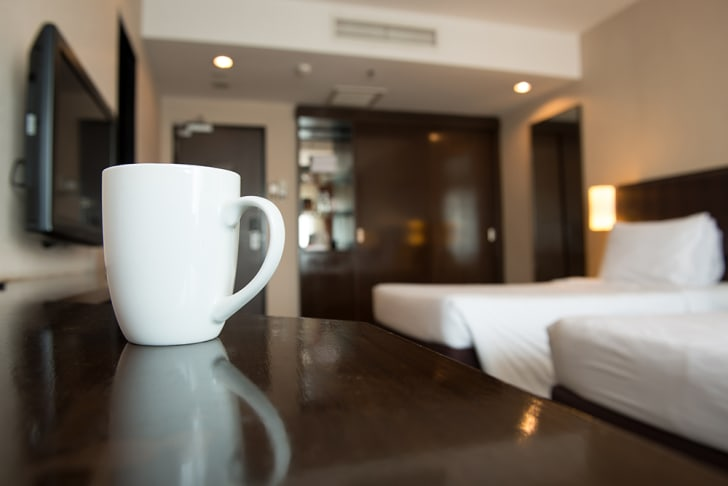 A cup in a hotel room