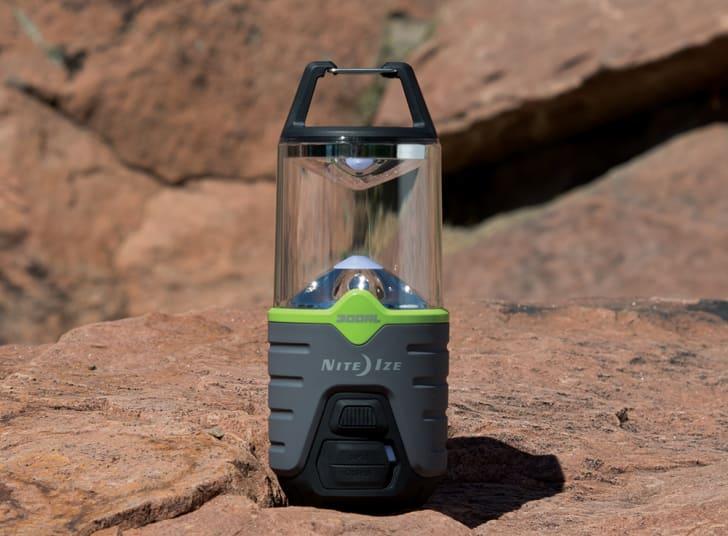 A Radiant lantern sits on a boulder on a sunny day.