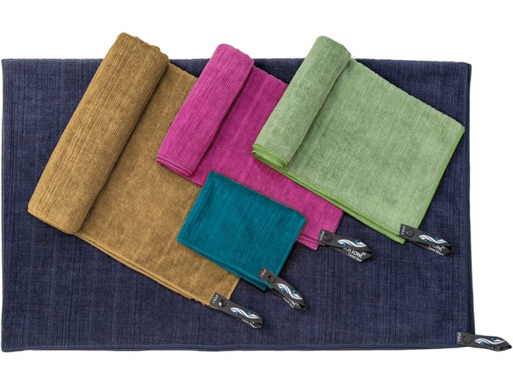 Five different colors and sizes of towels