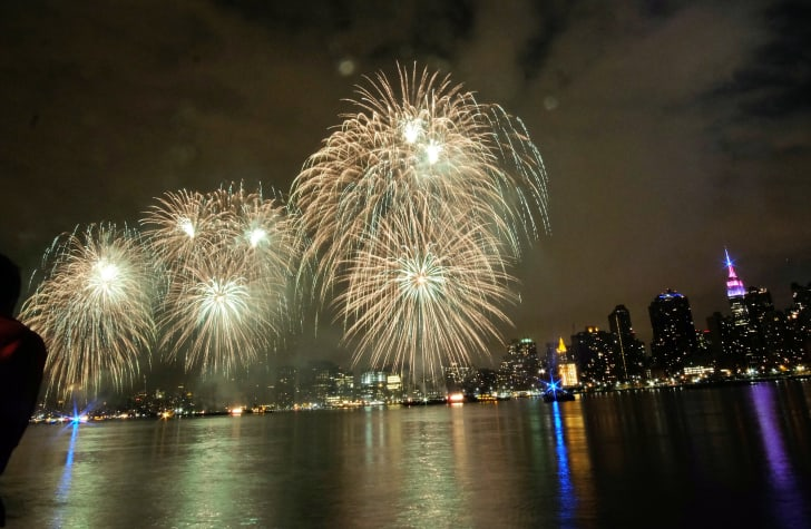 Fireworks burst over New York City.